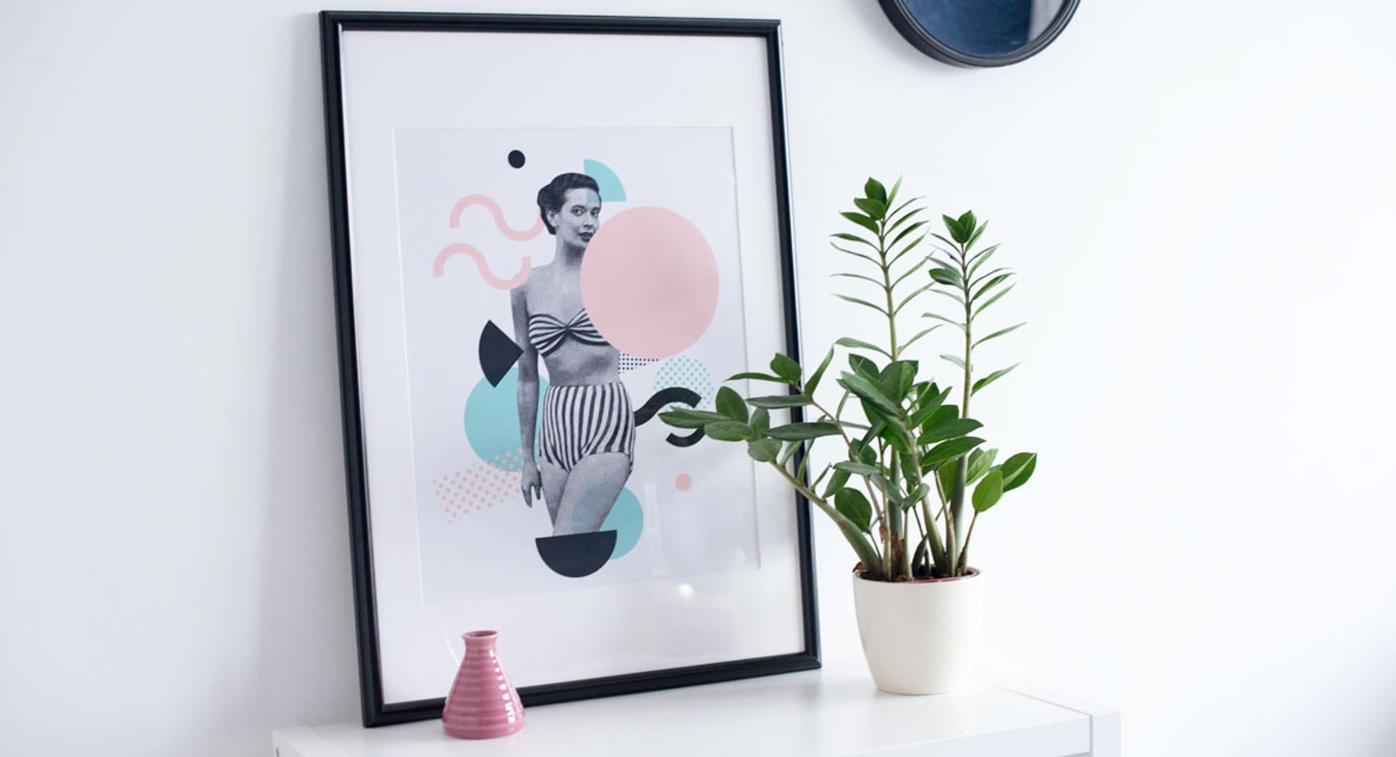 Kommode mit einem Bild und einer Pflanze